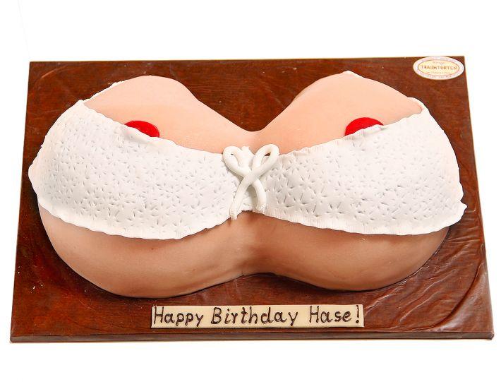 Brüste in Spitzenkörbchen Torte