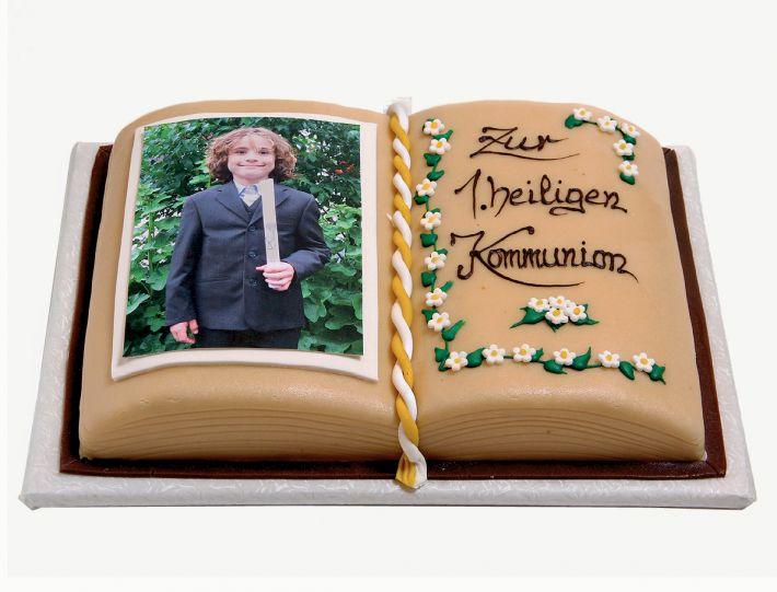 Kommunion und Konfirmation Aufgeschlagenes Buch Torte
