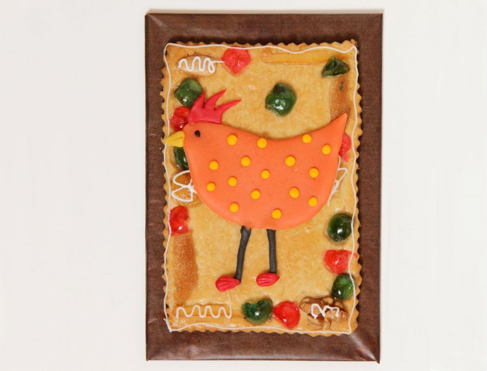 Gepäckplatte mit orangem Huhn