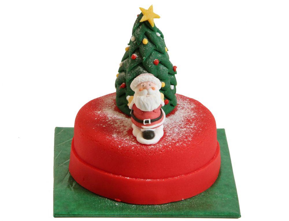 Weihnachtsmann vor Tanne Torte